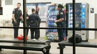 lax airport police man with a  Weapon at Los Angeles International Airport