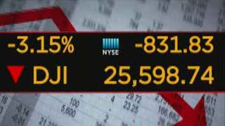 Dow tumbles more than 800 points over interest rate worries