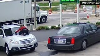 Woman jumps on hood of car to stop thief