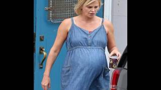 Charlize Theron dons faux baby bump beneath denim dress filming scenes Tully