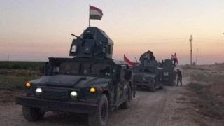 Iraqi forces retake disputed city from Kurds