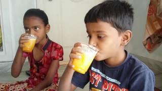 Village kids making of Orange juice recipe