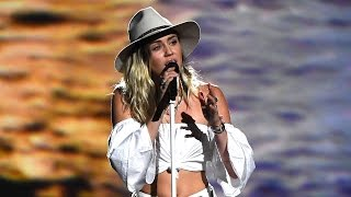 Watch Miley Cyrus Tear Up While Singing