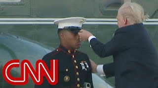 Trump lends hand to Marine whose hat blew away