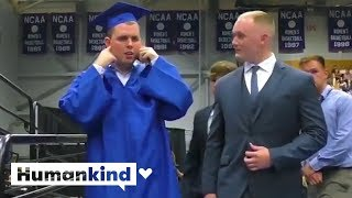 Auditorium goes silent so autistic student can accept diploma | Humankind
