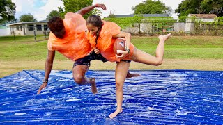 KNOCKOUT BUBBLE WRAP FOOTBALL ON A SLIP N SLIDE vs. MY GF!