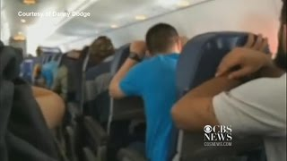 Watch: Passengers brace for emergency plane landing