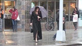 EXCLUSIVE - Caitlyn Jenner grabs a Starbucks in NYC under heavy rain