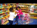 Toys AndFun Sisters Doing Shopping At Th...